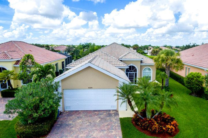 This is the one you've been waiting for. Enjoy resort style living in this glorious gated community within Tradition Port Saint Lucie. This beautiful 2000 sq. ft. 3 bedroom, 2 1/2 bath quality DiVosta solid poured concrete home includes a Dining Room and office and has been fully renovated from floor to ceiling, featuring high-end fixtures and finishes throughout. This contemporary styled home offers 10' - 12' ceilings throughout with 8' solid interior doors, generously sized living and family rooms leading to enclosed patio and lake making this house perfect for entertaining.