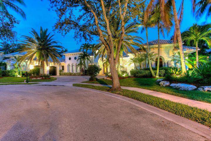Custom Built by National Custom Homes this is the Crown Jewel of The Preserve. Featuring the only double lot in the community at over 1/2 acre. Super private & quiet. South Beach meets Boca Raton in this completely updated estate home with nearly 6200 square feet of ultra luxury living all on 1 level. Split bedroom plan with kids wing each bedroom has a brand new ensuite bath. The master is spacious with custom wood floors & closets not to mention resort style his & hers bathrooms overlooking a lush, screened private pool with waterfalls. Additionally, a ''two story'' custom office/library will please any executive. The custom home theater features lush accomodations for your viewing pleasure. Brand New Kitchen is stunning. The outdoor summer kitchen & patio w/fireplace is a show stopper!