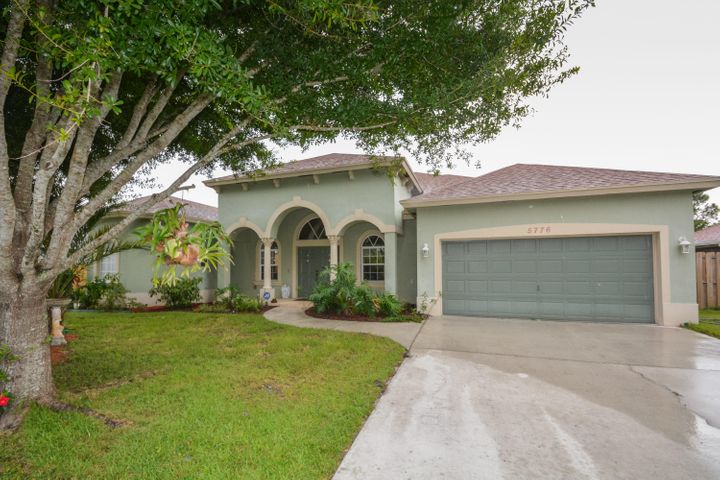 This beautiful four-bedroom, three-bathroom and two-car garage home is conveniently nestled within the beautiful Torino area of western Port St. Lucie, Florida. This tranquil location is in proximity to the area's best dining and shopping. Offering a welcoming feeling as you pass through the columns of the impressive porch and foyer. The floor plan encompasses a spacious living room and family room on each side of the hallway. The spectacular kitchen provides enormous space for entertaining while preparing and enjoying meals at the adjacent bar, breakfast room and dining room. The master bedroom features an impressive Jacuzzi Tub and a Dual Head Sports Shower. Torino is north of St. Lucie West and south of Midway road with easy accessibility to the turnpike and I-95. This desirable neighborhood is immersed in nature and located 5 minutes outside of the city. Call today for more information and a complete list of all the home's features and community information. SPECIAL ENERGY EFFICIENT FEATURE::2014 Solar Hot Water Heater, 4.2 Kilowatt Solar Energy System coupled with a 16 Seer A/C brings the Average Electric Bill $100 per Month!!!
