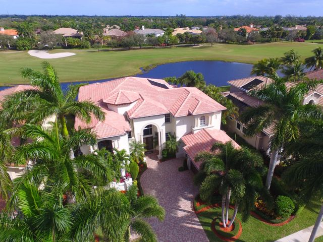 Best location in Mizner Country Club! Enjoy the fabulous views of the 18th hole of the spectacular NEW golf course. This 5 BR 5.3 bath luxury home features 2 Master Bedroom suites. First floor MBR with updated luxury bath and sitting room, plus one BR ensuite downstairs. Second MBR with luxury bath, and 2 addl BR upstairs all in great split plan. 24' ceilings in LR and DR. Many upgrades including newer 3 zone AC, Built-ins, Custom decorator office, Bar with onyx counters, Butler's pantry, Whole house Generator with 1,000 gal tank, Elevator, Designer motorized Chandeliers, Custom closets, Custom drapes, 16 x 40 lap pool, Outdoor kitchen, Finished Garage, Lush landscaping with 7 Royal Palm Trees. Recently painted, very well maintained and in excellent condition. Golf Equity Purchase required