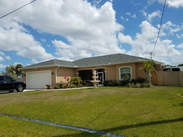 A MUST SEE HARD WOOD TILE THROUGHOUT LARGE KITCHEN WITH ISLAND LARGE BONUS ROOMS
