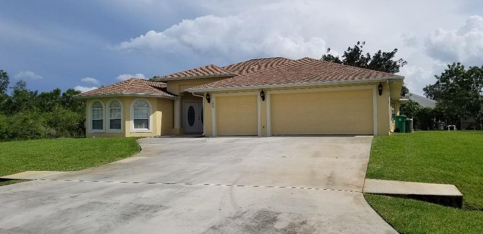 Welcome Home to Port St. Lucie County most beautiful neighborhoods. This beautiful custom home sites on over 1/2 an acre with over 3,300 Sq Ft of living space. This home features vaulted ceilings a spacious family room with open space to the kitchen's breakfast nook, Separate formal dining room and living room. Master bedroom has lots of space w/ roman tub double sink and large walk in closet, 4th bedroom is currently being us as a den. This beautiful home has a screened patio, covered porch and fruit trees and so much more.