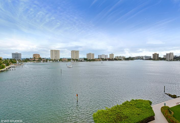 Stunning wraparound vistas of Lake Boca Raton and ocean from every room! Coveted corner condo, private and impressive! Huge covered 534 sq. ft. balcony with storm shutters and impact bay windows in the kitchen breakfast room and convertible den/office. Mizner Tower is a pet friendly, full service condominium with valet, doorman, resident manager, pool attendant and concierge. Fabulous amenities including 2 tennis courts, large pool, dockage, 2 whirlpool spas, separate clubhouse, 2 fitness rooms, lounge area, pool snack bar, and more! Live adjacent to the world famous Boca Resort and Club, and be in waling distance to downtown shops and restaurants, the beach, and resort amenities. Have it ALL with this special and amazing offering, with designer upgrades throughout.