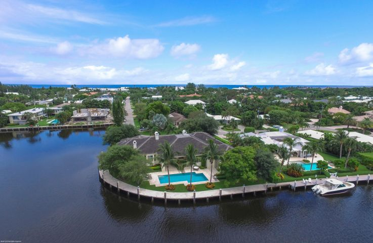 This Beautiful Custom Built One Story Gated Estate is situated on an Intracoastal Point Lot with over 253+/- of Waterfrontage in a desirable ''Slow Wake Zone.'' This is truly one of the Best lots in East Delray. The property is only Blocks to Atlantic Avenue and the Beach. Features Include an Open Concept Floorplan. Volume Ceilings, a Large Great Room with Fireplace, an eat in Kitchen boasting a huge center island, a beautiful brick designed Stove area and separate formal Dining Room, an Office/Den off the Master which includes a sitting area, a large Exercise Room & a glorious master bath. There's a separate ''wing'' w/3 en suite bedrooms which surround their own family Room The outdoor area is a dream w/a huge covered loggia, summer kitchen w/ pizza oven and Dockage for a large Yacht!
