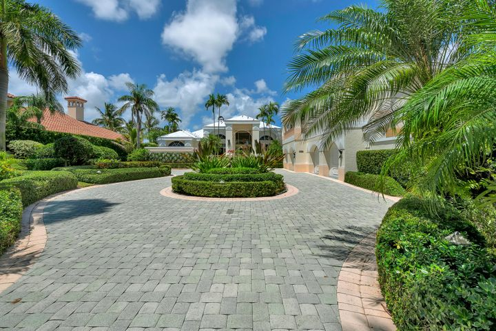 Beautiful custom built 5 bedroom / 5.2 bathroom waterfront home in Admirals Cove.  Located on a large lot with direct access to the Intracoastal Waterway.  This unique home includes a custom soundproofed home theatre with a 100'' projection screen with state of the art equipment. There is a full 4-car garage with A/C, and room for up to an 80' boat.  A new roof was just installed at the end of 2018. The dock includes a 12k lb lift and a jet ski dock.  The house is surrounded with beautifully appointed landscaping that is highlighted at night with extensive exterior lighting.  A summer kitchen and gazebo provide a resort style pool that is heated with solar panels.  Rare Social membership must be sold with property.