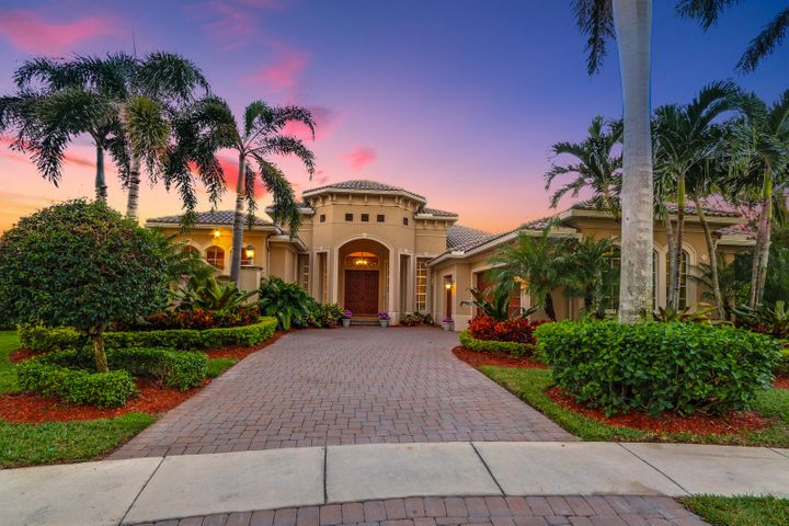 Twilight front elevation and grand foyer. Turned garage creates the ultimate curb appeal.