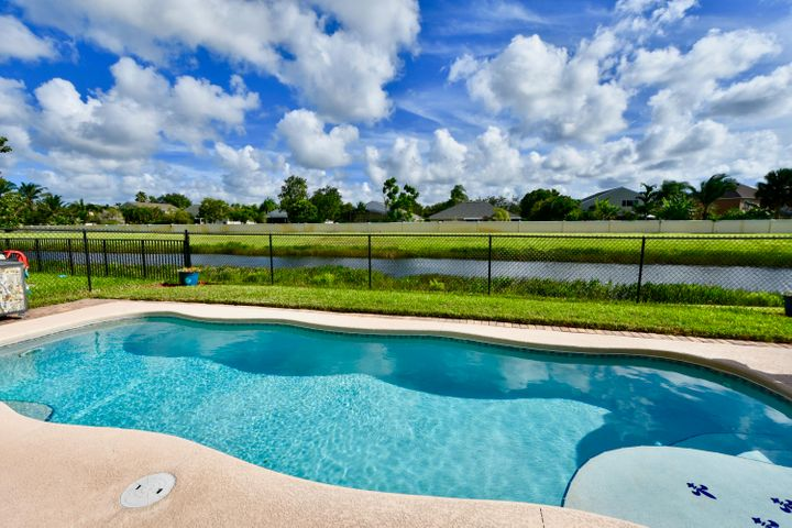 NOT ONLY DOES THIS HOME HAVE BEAUTIFUL POOL & LAKE VIEW, BUT NOTE, NO NEIGHBORS BEHIND HOME