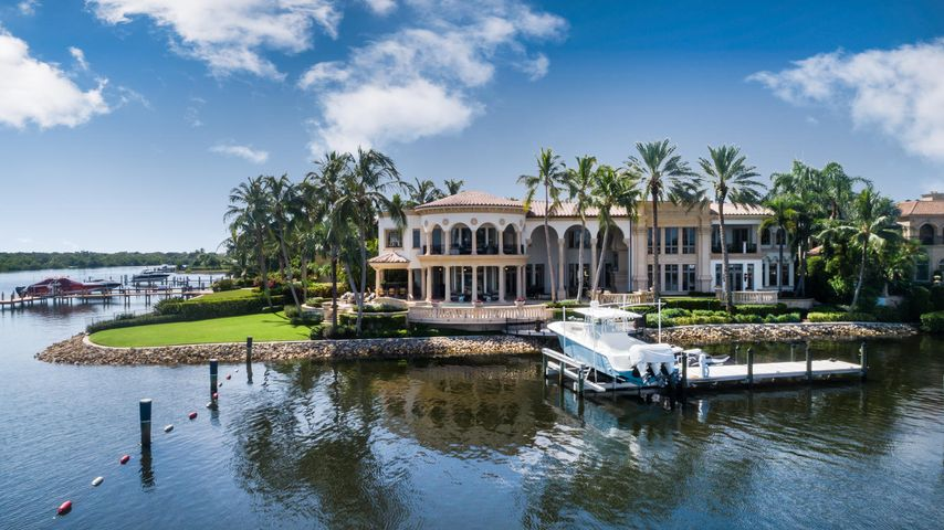 Located in the prestigious gated community of Admirals Cove, this stunning Mediterranean style home is situated on 225' of water frontage on a direct Intracoastal point lot with panoramic views of the waterway.  Offering the ultimate in luxury and privacy, the property boasts exquisite details throughout and provides the best of indoor and outdoor living.  Built in 2000, the 15,619 +/- total square foot residence has 5 bedrooms, 7 full baths and 1 half bath with spacious outdoor loggias, a waterfront pool, a dock located on a protected canal, a 3-car garage with an additional golf cart bay, a brand new full house generator, hurricane impact doors and windows, and much more.  Admirals Cove has every amenity imaginable from 45 holes of golf, 2 driving ranges, 2 club houses, a marina, a gym, Located in the prestigious gated community of Admirals Cove, this stunning Mediterranean style home is situated on 225' of water frontage on a direct Intracoastal point lot with panoramic views of the waterway.  Offering the ultimate in luxury and privacy, the property boasts exquisite details throughout and provides the best of indoor and outdoor living.  Built in 2000, the 15,619 +/- total square foot residence has 5 bedrooms, 7 full baths and 1 half bath with spacious outdoor loggias, a waterfront pool, a dock located on a protected canal, a 3-car garage with an additional golf cart bay, a brand new full house generator, hurricane impact doors and windows, and much more.  Admirals Cove has every amenity imaginable from 45 holes of golf, 2 driving ranges, 2 club houses, a marina, a gym, restaurants, a salon and spa, a new tennis complex with tennis and pickle ball courts, playgrounds and children's programs, dog parks, additional car storage, and full time security.