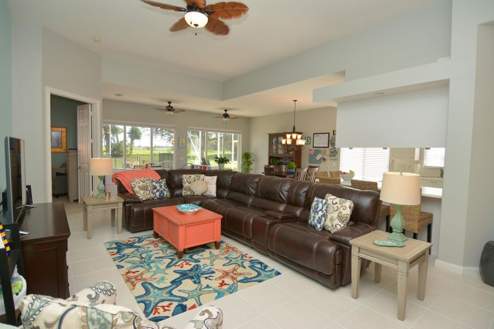 OPEN AND AIRY FAMILY ROOM WITH 10 FT CEILINGS.