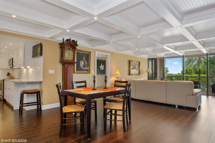 Exquisite coffered ceilings with beadboard in-lays house an abundance of recessed lighting on dimmers