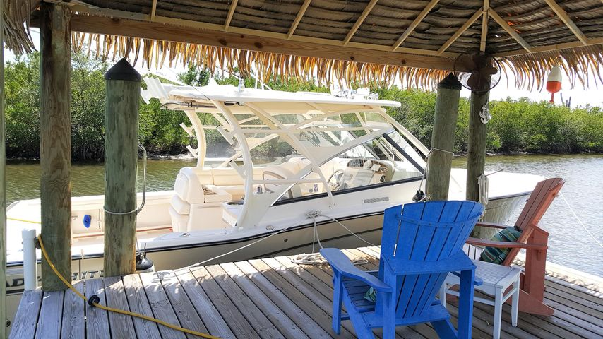 Boaters Dream! Water and electric, additional 12,000lb boat lift also!