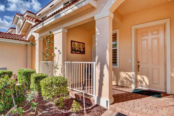 Cozy, paver porch to enjoy the warm summer days.