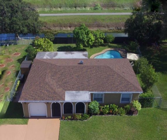 Welcome home to this 3 bedroom, + DEN, 2 bath pool home on the water.