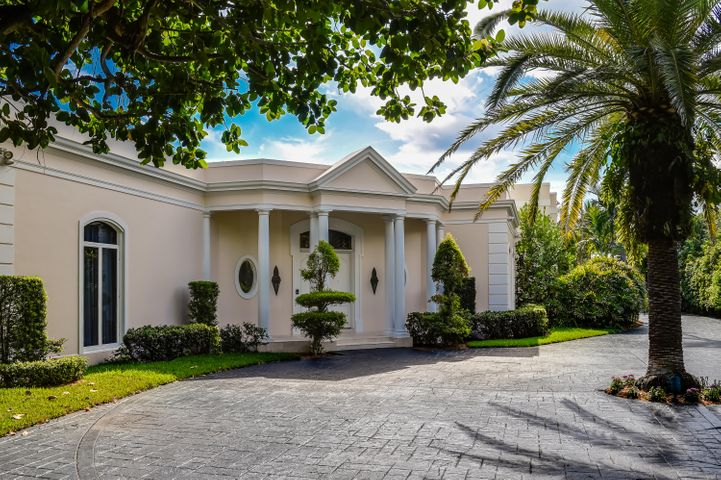 An exceptionally situated Regency home in the Estate Section, built by renowned Palm Beach developer Robert Gottfried.  The Gottfried design wraps around the Clarence Mack pool house, once part of the home known as ''Elephant Walk''. Beautifully proportioned living areas are designed for extravagant entertaining or relaxed privacy, each room having exposures to the lavish pool and open landscaped backyard. The main house has a master suite on the first floor with a private patio extending towards the pool. Other features include a home office with a full bar off the Florida room, dining room, formal living room, library with a bar, 1 wet bar, 2 kitchens, sauna & 3 car garage. Upstairs, there are 3 additional bedrooms en suite.
