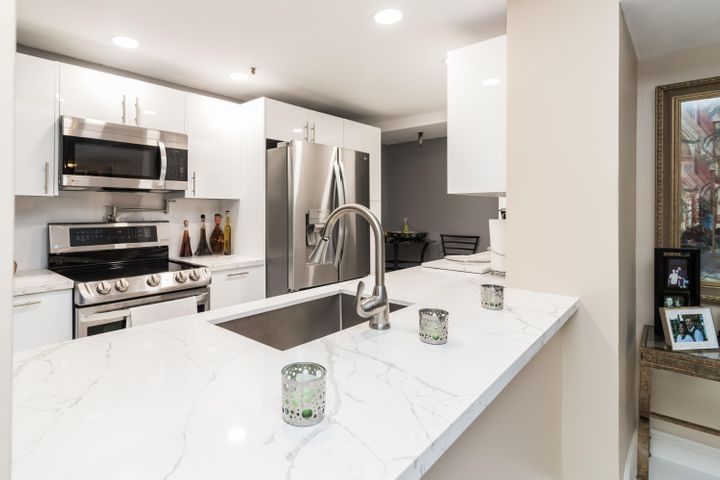 Completely Remodeled Kitchen, with Rear Breakfast Nook - a feature unique to this unit. Pantry cabinetry added with pull-out drawers!