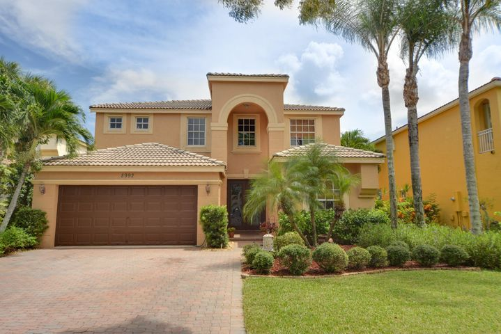 Beautifully landscaped w/wide paver drive way.