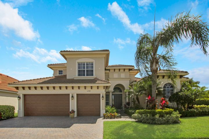 Stunning 5BR+DEN/5BA/3CG POOL & SPA home in the sought after Estates at Tradition community! This Toll Brothers built home incorporates quality finishes t/o. Upon entry into the living room, you'll quickly be captivated by the beautiful pool & spa through the large picture window. Chef's kitchen opens to the family room and features granite, 42'' upper cabinetry, double ovens, gas range, two sinks, dual pantries and kitchen island! Master bedroom on the first floor has access out to lanai and two large walk in closets. Serene master bath has dual vanities, frameless glass shower & soaker tub.   Two additional bedrooms w/ bathrooms on the main floor. The upstairs features two spacious bedrooms, each with their own bathroom, loft area w/ custom built wall unit and plenty of space to lounge. Extra features include butler's pantry, fireplace in living room, glass french doors to den, crown molding, high end light fixtures and fans, additional storage space, lush landscaping and lake views from front of the home.  Completing this home is the wonderful outdoor area - perfect for Florida living! The Estates at Tradition has walking paths throughout plus a community pool. Close to Tradition Square with restaurants, shopping and hospital.  Quick access to I95 from Tradition.  Call today to view this exceptional property!