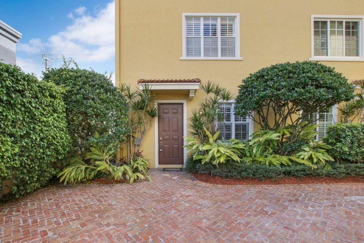 Downtown living! Gorgeous three story 2-car garage (end unit) Townhome in Courtyards of Delray. Completely upgraded and remodeled. The kitchen opens up to one of TWO living areas with black stainless steel appliances and quartz counter-tops. Dining room off the kitchen with dry bar and wine fridge.  Master bedroom features 2 closets and a beautifully updated bathroom with dual sinks, a soaking tub, and separate shower. Everything in the home is brand new. A/C and water heater are 2019. Community features heated pool and homes here are rarely available. One block from world famous Atlantic Avenue, named one of the top 10 shopping streets in America.