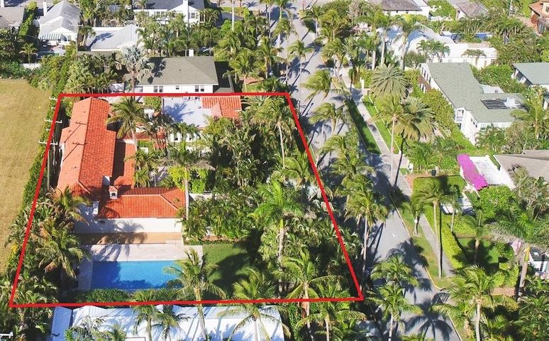 This exceptional and very special 8,256 sq. ft. house is situated on an 18,000+ sq. ft. lot. Located on one of the most desirable streets in the center of town with beach and lake trail access, this secluded property offers wonderful privacy with a delightful indoor/outdoor lifestyle. A 1925 era home, enhanced by John Volk in the 1960's and completely restored by Livingston Builders in 2000. Whole house generator!
