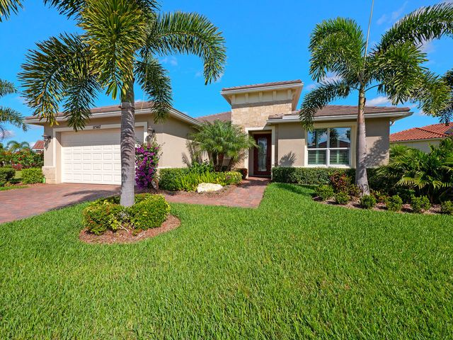 **MOTIVATED SELLER** Rare ''Treasure Coast'' model, located in the upscale Estate Homes section of Tradition's Vitalia community, boasts an oversize lot, like-new condition having only been occupied since 2015. Features over $90k in upgrades including closet built-ins & kitchen cabinets,Crown Moulding,Phantom retracting patio door screens,granite counters,front impact glass,plantation shutters throughout,extended-length garage,serene lake view from extended/screened-in patio w/ceiling fans, extensive landscaping w/uplighting, spacious laundry room w/deep sink & cabinetry,new bedroom flooring,efficient gas water heater, alarm, All appliances are virtually brand new. Enjoy the good life at the extensive Clubhouse & Pool! Looking for a Quick Close? This home is picture perfect & move-in rea Other Upgrades include: Travertine exterior facade detail, UV A/C Sterilizer, floor tile on diagonal.