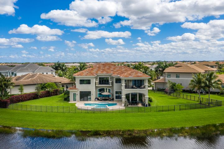 THIS MAGNIFICENT DECORATOR FINISHED EXPANDED PALAZZO IS SITED ON ONE OF THE BEST CUL-DE-SAC, HALF ACRE, PIE SHAPED WATERFRONT LOTS IN SEVEN BRIDGES!  THE BACKYARD IS HUGE & THE VIEWS ARE BOTH SPECTACULAR & SERENE.  CIRCULAR MARBLE PAVED DRIVEWAY LEADS TO A DOUBLE DOOR ENTRY WHICH OPENS TO THE LARGE WELCOMING FOYER.  THE LIVING ROOM W/ WALL OF GLASS LOOKS OUT TO THE BEAUTIFUL TOTALLY PRIVATE OVERSIZED POOL & GROUNDS, WITH WIDE LAKE VIEWS & MANICURED LAWN & TREELINE BEYOND.  THE CLUB ROOM W/ WET BAR & BEVERAGE COOLER SHARES THESE AMAZING VIEWS.  A LARGE GRACIOUS FORMAL DINING ROOM IS LOCATED ADJACENT TO THE WONDERFUL CHEF'S KITCHEN W/ DOUBLE ISLANDS, 48'' WOLF GAS RANGE, 2 BOSCH DISHWAHSERS, SUB ZERO REFRIGERATION, REVERSE OSMOSIS FILTRATION & 2 LARGE WALK IN PANTRY'S.  THE LARGE FAMILY ROOM AND BREAKFAST AREA SHARE THE MAGNIFICENT POOL AND LAKE VIEWS.  AN EN-SUITE BEDROOM AND MEDIA/PLAY ROOM ARE ALSO ON THE GROUND FLOOR.  THE SECOND FLOOR INCLUDES 5 BEDROOMS AND A LARGE CENTRAL FAMILY LOFT WITH SPECTACULAR VIEWS.  THE SUMPTUOUS MASTER SUITE HAS BEAUTIFUL WOOD FLOORING, BREAKSFAST BAR, PRIVATE BALCONY AND OVERSIZED WALK IN CLOSETS!  THE MASTER BATH IS SPECTACULAR WITH HIS AND HER WATER CLOSETS AND ONCE AGAIN, STUNNING VIEWS.  THE CENTRAL LOFT IS PERFECT FOR FAMILY ACTIVITIES AND IS SURROUNDED BY 4 MORE LARGE EN-SUITE BEDROOMS.  THIS IS TRULY A SPECTACTULAR HOME ON A VERY SPECIAL AMAZING LOT!