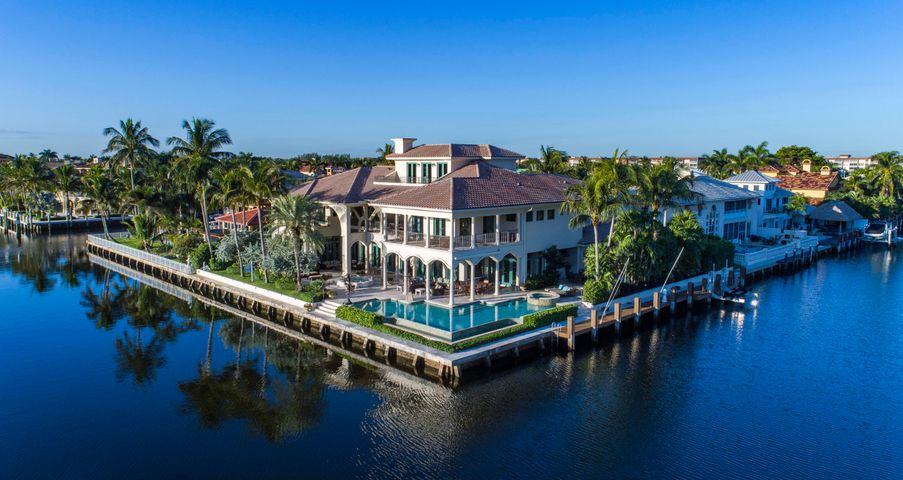 Prestigious Three Story Gated Intracoastal Point Lot Mega Mansion, 12,724 t sq ft, Smart Home, Lutron System, Crestron System, 272 Feet of Waterfrontage, a Yachtsmans Paradise. Elevator, fireplace, magnificent library, amazing clubroom/home theater, 3rd floor exercise room, impact glass, Chef's gourmet kitchen, whole house 100 kw generator, master suite with panoramic views, sitting room and his and her marble spa baths & wardrobes, salt water aquarium, resort style pool and spa. This Prestigious Gated Intracoastal Point Lot Estate has the finest outdoor living one could imagine with a summer kitchen, dockage galore and outdoor entertaining. Brand New 15K Hurricane Rated Boat Lift. 90 degree elevator boat lift.  Absolute Showplace! See supplement & full renovation list in Document section. 6 A/C Units All Lennox - ages: 2013, 2014(2), 2015, 2016(2)  Maintenance Contract with Atlantic Refrigeration High Efficiency Wifi Whole Yard, complete SWAT mosquito spray system