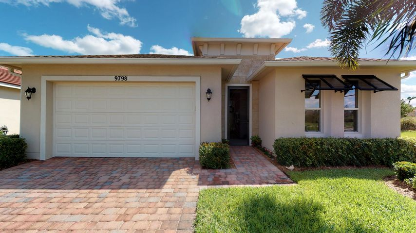 This rare ''Lauderdale'' model pool home in vibrant 55+ Vitalia at Tradition won't last long. Be sure to check out the 3D virtual walkthrough tour. Located on an expansive corner lot within close proximity to all the community amenities makes this ''sweetheart'' a must see. The spacious family room opens to an extended, screened, and covered lanai overlooking the near new sparkling pool. The kitchen boasts 42'' cabinets, granite counters, and S/S appliances. Step into the large master suite with a preserve view and find features including ample closet space, dbl. vanities, and a separate tub and shower.  Other conveniences include a walk in pantry and finished laundry room with cabinetry and sink. Come enjoy Vitalia's 24,000 s.f. clubhouse with resort style amenties. Every club imaginable!