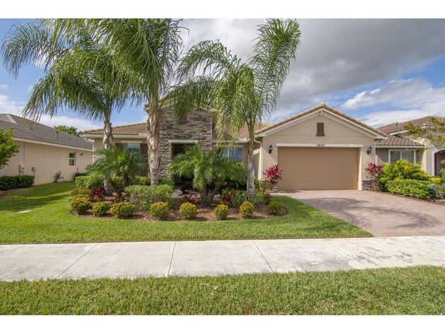 Resort Style Living Palm Coast Model built in 2015. This 4 bedroom, Den, 3 bathroom and Great Room home is in Vitalia at Tradition. The 2481 Living Area Sq. Ft. and 3329 Total Sq. Ft. is selling for only $393,900. Store your toys in the 4 Ft. extended Garage. Home boasts upgrades that include Full House Impact Glass with Triple Sliding Patio Doors to the Lanai. Oversized Master Bedroom has a Huge walk in closet, Gourmet Kitchen with Pantry, Gas option for Range/Oven and Water Heater, 42' Kitchen Cabinets, granite counter tops, 20x20 Tile, Oversized Dining Room has extra windows for additional sunlight. Oversized Screened in Lanai is for those who love to entertain. Additional cabinets in the Laundry Room and Drop Station by the Garage. Start living the Vitalia Resort Lifestyle. Start living the Vitalia Resort Lifestyle that includes Tennis, Bocce Ball, Pickle Ball, Club Rooms, Demo Kitchen, Fire Pits, Live Entertainment at the Grand Ballroom and to many clubs to list. There is a full time Events Coordinator in Vitalia.