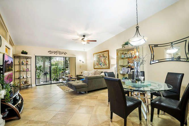 Beautiful 2/2 + den villa is located in a serene park like setting. This rare corner unit with a den has been completely updated throughout. New kitchen with 42'' wood cabinets, granite counter-tops & SS Appliances in an eat in kitchen. You will love the high vaulted ceilings and the neutral tile on diagonal throughout the main living areas. Both bedrooms have engineered wood floors and custom closets.  Bathrooms are also updated with counter height vanities  with granite on top. This is a must see in Boca Chase! Active Adult Clubhouse within walking distance includes pool, tennis, activities etc. Great Location! Close to Shopping, Publix and more!
