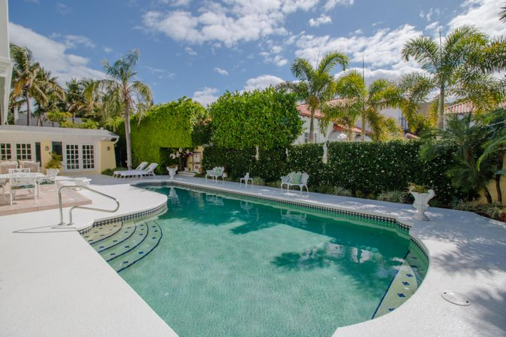 This home is located in one of the most desirable streets in Palm Beach.  Only 3 houses from the ocean, private beach access, huge drive, private street parking.  The house also offers a private pool cabana, perfect for entertaining pool side.  There is a guest apartment over the garage with full kitchen, (2) bedrooms, full bathroom and balcony. Last updated in 2004.