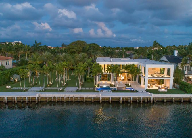 "Museum Modern Intracoastal Estate sited on two prized waterfront lots (200+/- ft) in Old Boca Raton's ''Estate Section'' originally built  (2015) by high-end builder J.H. Norman, innovative architect George Brewer and award winning Marc-Michael's Interior Design.High impact Architectural design encased in glass, stone and organic/earthy wood detailing.Resort-style pool/patio with lush landscape park-like grounds for large gatherings.Shown to pre-qualified buyers only. DISCLAIMER: The written and verbal information provided including but not limited to prices, measurements, square footages, lot sizes, calculations and statistics have been obtained and conveyed from third parties such as the applicable Multiple Listing Service, public records as well as other sources. All information including that produced by the Sellers or Listing Company are subject to errors, omissions or changes without notice and should be independently verified by any prospect for the purchase of a Property.  The Sellers and Listing Company expressly disclaim any warranty or representation regarding all information.  Prospective purchasers' use of this or any written and verbal information is acknowledgement of this disclaimer and that Prospects shall perform their own due diligence.  Prospective purchasers shall not rely on any written or verbal information provided when entering a contract for sale and purchase.  Some affiliations may not be applicable to certain geographic areas. If your property is currently listed with another agent, please do not consider this a solicitation for the listing. In the event a Buyer defaults, no commission will be paid to either Broker on the Deposits retained by the Seller.  ""No Commissions Paid until Title Passes.""  Copyright 2019 Listing Company. All Rights Reserved."