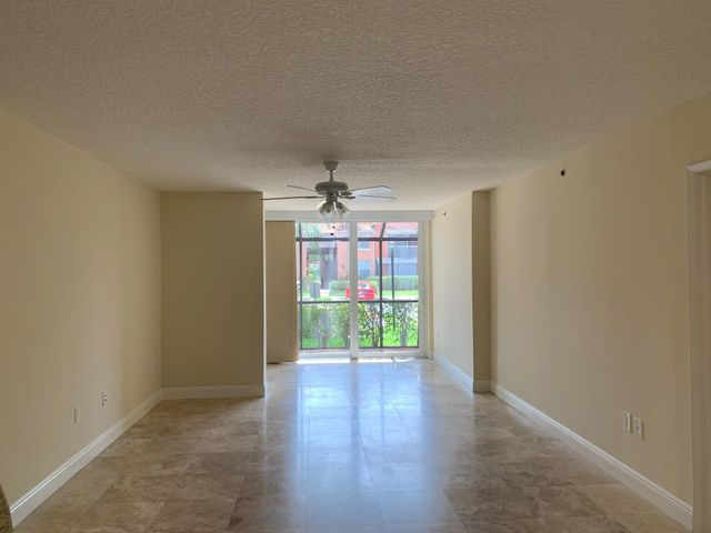 Renovated 2-bedroom ground level condo in the heart of Boca Raton! Light and bright with beautiful marble flooring throughout. Modern kitchen with granite countertops, stainless steel appliances, and lots of storage. Enjoy the Southern exposure from the screened patio with garden views. Bocar is an ideally located, resort-style community that offers a manned security gate, clubhouse, pool, tennis court, billiard room, fitness center, racquetball court, business center, and much more!