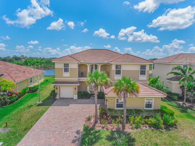 CBS HOME BUILT IN 2014 *GORGEOUS 2 STORY MEDITERRANEAN STYLE LAKE FRONT HOME! **3 CAR GARAGE SPACIOUS LIVING AREA, HIGH IMPACT WINDOWS,** GRANITE COUNTER TOP KITCHEN HAS ISLAND AND PLENTY OF CABINET SPACE, BARREL TILE ROOF, HIGH IMPACT WINDOWS, SPACIOUS DINING, LIVING, FAMILY ROOM, LARGE OFFICE/5TH BEDROOM, AND LOFT AREA. MASTER BEDROOM WITH ADJACENT OFFICE SPACE, LARGE DOUBLE WALK-IN CLOSETS, LIVING AREA HAS CERAMIC TILES.