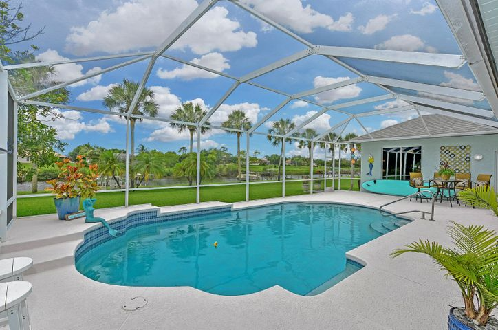 Best Kept Secret on the Treasure Coast, this Waterfront Community of 31 homes is a quick 20-minute boat ride to quaint downtown Stuart for lunch or 30 min ride to the inlet for fishing in the ocean. Update & Upgraded home with Class & Sophistication on 1/2 acre. New Kitchen offers plenty of cabinets & granite countertop space with pass-thru window to oversized porch overlooking waterway & screened pool. Light & Bright home with windows all across the back of the house. Deep water dock features 16lb boat lift and jet ski float.  Local community offers boat ramps & parks. Centrally located to shopping, restaurants, convenient to Turnpike and I-95. $37,000+ in upgrades. Add'l features: New A/C, Fresh paint in & out, New plantation shutter/blinds/shades, Landscape lighting. Call today! Sizes and Measurements are approximate. Buyer to verify all information please.