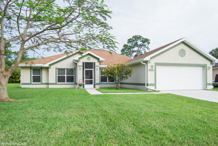 Well maintained spacious beautiful home, move in ready! 4/2/2 split plan plus Den in the center of Port St. Lucie! Close to 95, Turnpike, Tradition & St. Lucie West! Great location for commuters!  2,557 sq. ft. under air. Large great room with high cathedral ceilings and plant shelves. Formal dining, large kitchen and dinette, large master suite and bath with dual sinks, roman tub, shower and walk in closets. Large guest bedrooms with walk in closets.  New roof, gutters and appliances. Tinted windows, screened front porch and rear patio, large fenced back yard. Hurricane Shutters & 2'' blinds throughout home. Present all offers.