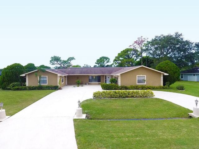 Beautiful and spacious 5 bedroom, 4 bath single family house in Port St. Lucie. This amazing 3, 169 sqft pool home sits on a 0.44 acre lot. The 5th bedroom and 4th bathroom are part of an attached efficiency that can be used as a mother-in-law suite, home office, etc. The recently painted circular driveway has plenty of space for a boat or an RV. If you like to relax, take a dip in the amazing salt water pool in the back. The house is conveniently located in a very quiet street less than 5 minutes away from Publix and a shopping center and 10 minutes away from the Treasure Coast Square Mall. Jensen Beach Park and the Turnpike are just about 10 miles away.