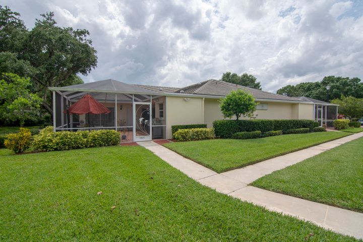 Beautifully remodeled 2 bedroom, 2 bath villa in desirable St Lucie West-within WALKING distance to grocery store, several restaurants and retail options, LA Fitness, banking- its all right here! Kitchen has been opened up to allow an open floor plan. Mirrored built in shelves, modern lighting. Tile in kitchen, dark wood everywhere else. High hat/canned LED lighting. brand new top of the line stainless steel matching appliances, new washer/dryer, updated kitchen fixtures. Barn door style shower door in master bath, new toilets in both bathrooms. Huge screened in, newly painted patio creates additional living space to enjoy the private garden view and exceptionally large yard space.