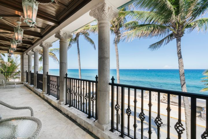 Masterfully crafted oceanfront Venetian Villa with 7,700+/- total square feet. Highlights include rich finishes, striking ocean views, soaring pecky cypress ceilings, detailed marble fireplaces, and oceanfront balconies. With its gracious floorplan and attention to detail, this exceptional Penthouse lives like an elegant estate.Private elevator opens to stunning foyer, leading to Grand waterfront living room through gallery with old world rolled ceilings. Unparalleled luxury with perfectly scaled rooms including mahogany library, media room, and formal dining room. Fantastic eat-in chef's kitchen features top-of-the-line appliances and wine room. Elegant Master Suite complete with fireplace, dual bathrooms, walk-in closets, and dressing rooms. The expansive lower level features a spacious guest suite with en-suite bath, cabana bath with dressing room, and 2 car garage. Spacious family room with kitchen opens to oceanfront covered loggia and private pool. Perfect In-Town location, just two blocks to Worth Avenue.  To be sold As Is. All sizes approximate and subject to verification. Sq. Ft. per floor plan.