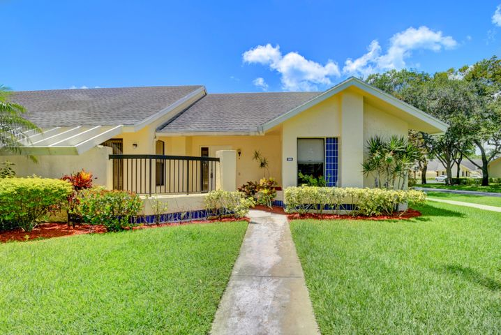 Beautiful hard-to-find CORNER LAKEFRONT VILLA in a gated, secure 55+ community. SPECTACULAR SERENE LAKE VIEW FROM SCREENED PORCH, LIVING ROOM, & MASTER BEDROOM. 2 car parking right in front. A/C--2017. New floors are gorgeous 24-inch marble look tile throughout. Spacious living/dining area features a bar and vaulted ceilings. Eat-in kitchen with charming breakfast area. Master bedroom features walk-in closet. 2 pets allowed up to 20 lbs each. 2 parking spaces. Active community has a clubhouse, pool, tennis, exercise room, and more! Low HOA fee includes cable, exterior paint, lawn care, recreation, & security gate. Close to lots of shopping, dining, and recreation. Available furnished, partially furnished, or turnkey.