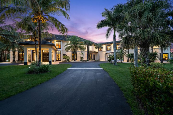 This beautiful custom estate(completely furnished) on 7.6 wooded acres in Ranch Colony, Jupiter, offers the quality, privacy and security, like no other home.Quality:  The 2-story custom home has 12,347 SF of living space with a total of 6 bedrooms and 81/2 baths, including the 3,649 SF guest house.  The first thing you'll notice as you enter the home, is the high quality solid oak 9ft double doors.  Just as impressive are the polished marble floors throughout the living areas on the 1st floor.   The living room, family room, gourmet kitchen, dining room and office/library all have beautiful views of the outdoor pool and natural areas.  A grand double staircase made from Brazilian redwood leads to the 2nd floor and serves as the main focal point....Cont The upstairs master suite includes a sitting area, his and hers built-in custom closets, a fireplace and a large en-suite bathroom with an over-sized jacuzzi tub.  A balcony off the master suite provides picturesque views of the lake and preserve.  Also, on the 2nd floor there are two additional bedrooms with en-suites, a home theater that seats 8, and an exercise room.  Each room on the 2nd floor has its own thermostat.  Hardwood floors are throughout the 2nd floor and guest house. Some of the features you don't see, but illustrate the high quality and thoughtful planning of the home is the energy efficient Icynene insulation in the roof.  That same quality on the interior carries through to the outside.  For example, there is a retaining wall around the pool deck of the 55' resort style heated pool, and the superior construction of the roof.  Privacy:  Ranch Colony is a unique community encompassing 1500 acres, located 4 miles west of I-95 and the Florida Turnpike.  There are five unique communities within ranch Colony and 257 homesites (see documents for a complete description of Ranch Colony).  Ranch Acres is one of the 5 communities that has 5 to 9 acre lots.  This home is set back from the road with a winding driveway and has its own private gate.  This peaceful and secluded lot on a lake borders on a large preserve.  Breath taking views of the property can be seen from any of the 3 balconies.  Security: Ranch Colony is a gated community with 24/7 manned security.  In addition, there is an electric gate at the entrance of the driveway, as well as an alarm system in the home.  All windows and doors have impact glass and there is a generator to provide power in the home in the event of a storm. You will not find a more secure home or community.