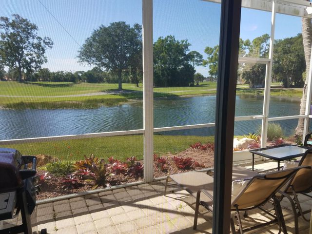 Rare Southern Exposure, most private corner Townhome with amazing wrap-around water and golf views from every window! Renovated! Granite kitchen, stainless appliances. 2 car garage. Walk to Resort/Hotel/Club.