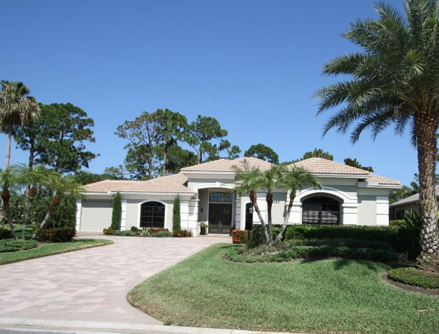 Home has a two car garage and owners added an addtional two golf cart garage.