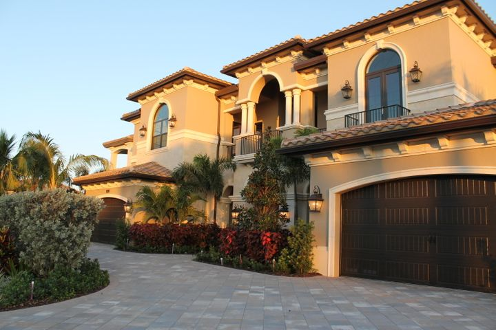 Extraordinary Value!  Palazzo model boasts 10-foot windows and sliding glass doors, open and bright floor plan with views of the pool and lake. State-of-the-art systems integrated into the home: Lutron lighting and wiring throughout the home for, TV, sound, climate control. The kitchen features Wolf appliances, wine coolers, a 4 foot range, double ovens, two dishwashers and walk-in pantry. Outdoor living is what really makes this home special and includes two covered loggias, outdoor kitchen, resort style pool with waterfall and spa. The master bedroom suite includes a private covered balcony, wet bar, his and hers giant walk in closets.