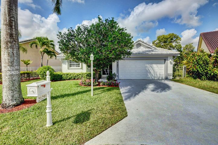 Enjoy this exquisite upgraded ranch style model in the heart of Boca Chase. Built and designed with pure elegance and warmth on a great lake lot, features 2 bed (original had 3 bed) 2 baths, 2 car garage on one of the best cul-de-sac lots in the community. The formal living area is warm and inviting with high ceilings. Large gourmet kitchen with white cabinets, granite counter tops, and newer appliances, opens up to a beautiful family room and large eat-in kitchen area. Newer A/C,  accordion shutters throughout. Both bathrooms are updated, large enclosed patio looking over private lake. Shows absolutely nice!!!!