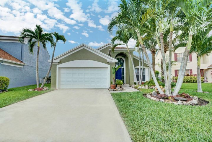 Check this out!!! Updated Home Beautiful Kitchen, Bathrooms, Flooring, all on tranquil lake view.  Very Clean and ready to move in.  Sought out Boca Winds.  Good for Starter or Empty Nestor etc. Low Hoa Fees.  Walk to Schools.  Quiet area but everything is nearby.