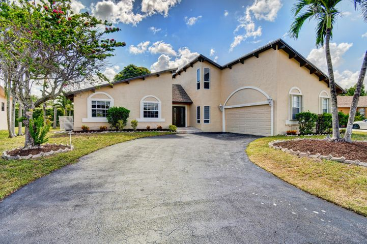Rare opportunity to own a well maintained 5 bedroom home in Boca Raton's highly desirable Logger's Run - Cimarron community. Located on the end of a cul-de-sac and complete with all new impact doors and windows! The home features an open kitchen and great room, with formal dining space, and formal living room. Vaulted ceilings throughout the first floor - including the bedrooms. Breakfast nook with built-in bench. Master bedroom (with new updated master bath), and 2 bedrooms downstairs, and 2 more bedrooms upstairs with additional loft space. Over 2600 square feet of living space. New roof, 1 year old water heater, newer AC/HVAC system, and new master bathroom.