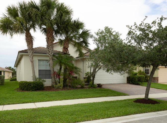Spacious 4/2 home with NO CARPETING!  Located in Heritage Oaks in the highly desirable Tradition community. High ceilings, covered and screened patio. All appliances including washer and dryer.  Move in ready.  Community includes Club House, pool and exercise room.  Close to I-95 for easy commute to WPB.  Start packin'!