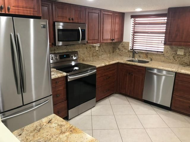 2 BEDROOM, 2 BATHROOM, 2ND FLOOR UNIT, OVERLOOKING LAKE AND GOLF COURSE, UPDATE KITCHEN WITH GRANITE COUNTER-TOPS, BRAND NEW STAINLESS STEEL APPLIANCES, A/C AND WATER HEATER 3 YEARS NEW, NO CARPET, ALL TILE, LARGE ENCLOSED BALCONY, UPDATED BATHROOMS, BUILDING HAS ELEVATOR!