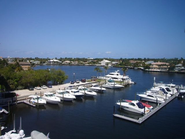 MAGNIFICENT 2 STORY UNIT IN WATERFRONT CONDO!! RENOVATED 2 BDRM 2.5 BATH IN GATED INTRACOASTAL COMPLEX. IMPACT SLIDING DOORS, VAULTED CEILING. EAT IN KITCHEN. THIS UNIT BOASTS A SPACIOUS OPEN FLOOR PLAN WITH INCREDIBLE VIEWS AND BROAD BALCONIES ON EACH FLOOR OF THIS 2 STORY UNIT OVERLOOKING THE MARINA AND INTRACOASTAL WATERWAY.  RAISED CEILING IN KITCHEN WITH HIGH HAT LIGHTING, GRANITE COUNTERTOPS & KITCHENAID STAINLESS STEEL APPLIANCES. RENOVATED BATHROOMS. SITTING ROOM OFF MASTER BEDROOM OVERLOOKS MARINA!!  DOCKAGE MAY BE AVAILABLE TO ACCOMMODATE UP TO 80 FOOT BOAT!FURNITURE SHOWN IN LISTING PHOTOS IS NOT AVAILABLE! CALL DOCKMASTER FOR RATES AT BEAUTIFUL PRIVATE MARINA COMPLETE WITH FUEL DOCK AND SHIP'S STORE  THIS IS DELRAY'S PREMIER WATERFRONT PROPERTY AND AMENITIES INCLUDE: A LARGE HEATED POOL OVERLOOKING THE INTRACOASTAL WATERWAY, GATED COMMUNITY WITH GUARD HOUSE,UNDERCOVER PARKING GARAGE, LUSH LANDSCAPING, AND SPACIOUS COMMON AREAS. AWESOME LOCATION JUST MINUTES TO ATLANTIC AVENUE SHOPPING & DINING, PRISTINE DELRAY BEACHES AND I-95 CONVENIENCE.