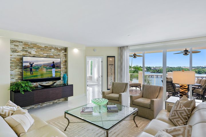 Stunningly redesigned & remodeled three-bedroom residence with direct Intracoastal views. This is the first time a remodeled residence at the Jupiter Yacht Club is being offered for sale. No expense has been spared, including 9ft ceilings, with floor-to-ceiling hurricane sliding doors, electric shades, elegant 32'' glass tile floors throughout, redesigned kitchen, with all new cabinets, new appliances, wine cooler, center isle and thick quartzite countertops, new soffits and LED lights, new custom closets, designer plumbing fixtures and a stacked stone wall. Offering the ultimate in privacy, with private elevator access and two secluded patios, this elegant condo retains the value of peaceful living while being conveniently close to everything. The Jupiter Yacht Club is located in the heart of Jupiter, a skip from area hotspots, such as the newly opened Harbourside with an array of fine dining and shopping, and within walking distance to miles of unspoiled beaches! Amenities include two under-building parking spaces, a manned front desk, a salt water pool and Spa and a summer kitchen / BBQ area, as well as bicycle and paddle board / kayak storage - and a private beach on the Intracoastal, for launching. Did we mention the protected Marina? Docks are available for purchase or lease!